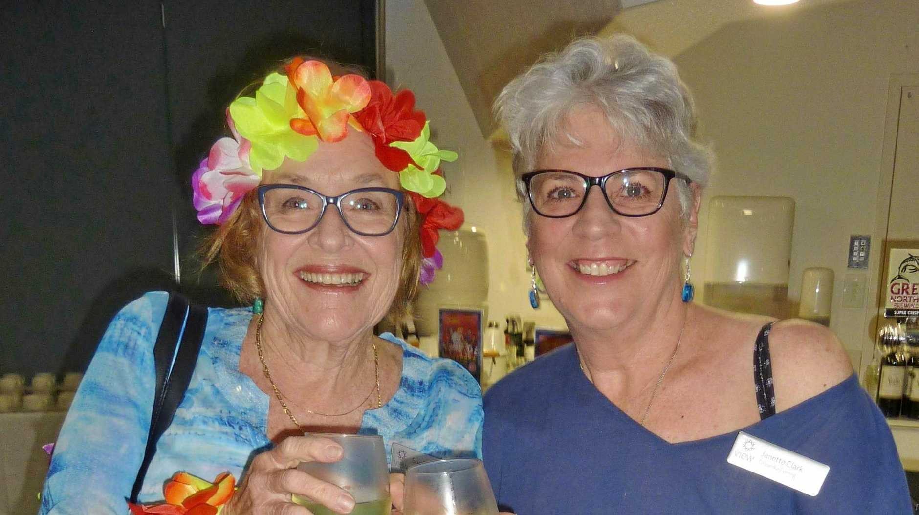 GOING TROPPO: Susan Carter and Janette Clark celebrate the Caloundra VIEW Club's 24th Birthday with a beach party theme.
