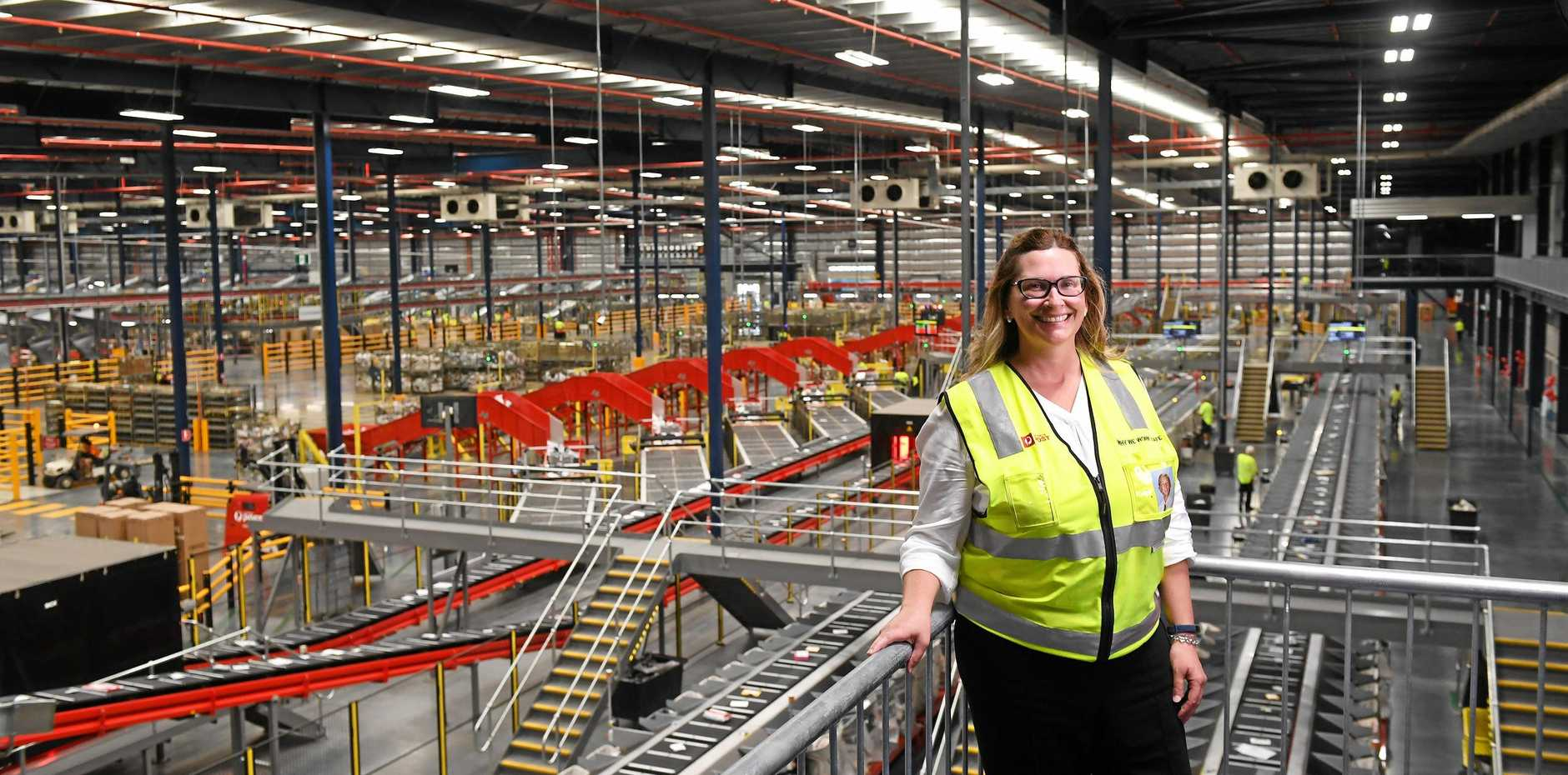 Australia Post Queensland, South Australia and Northern Territory deliveries general manager Angela Creedon inside the new parcel facility and delivery centre in Redbank.