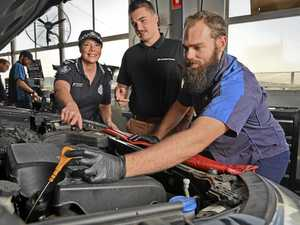 Women learn basic car care tips in special workshop