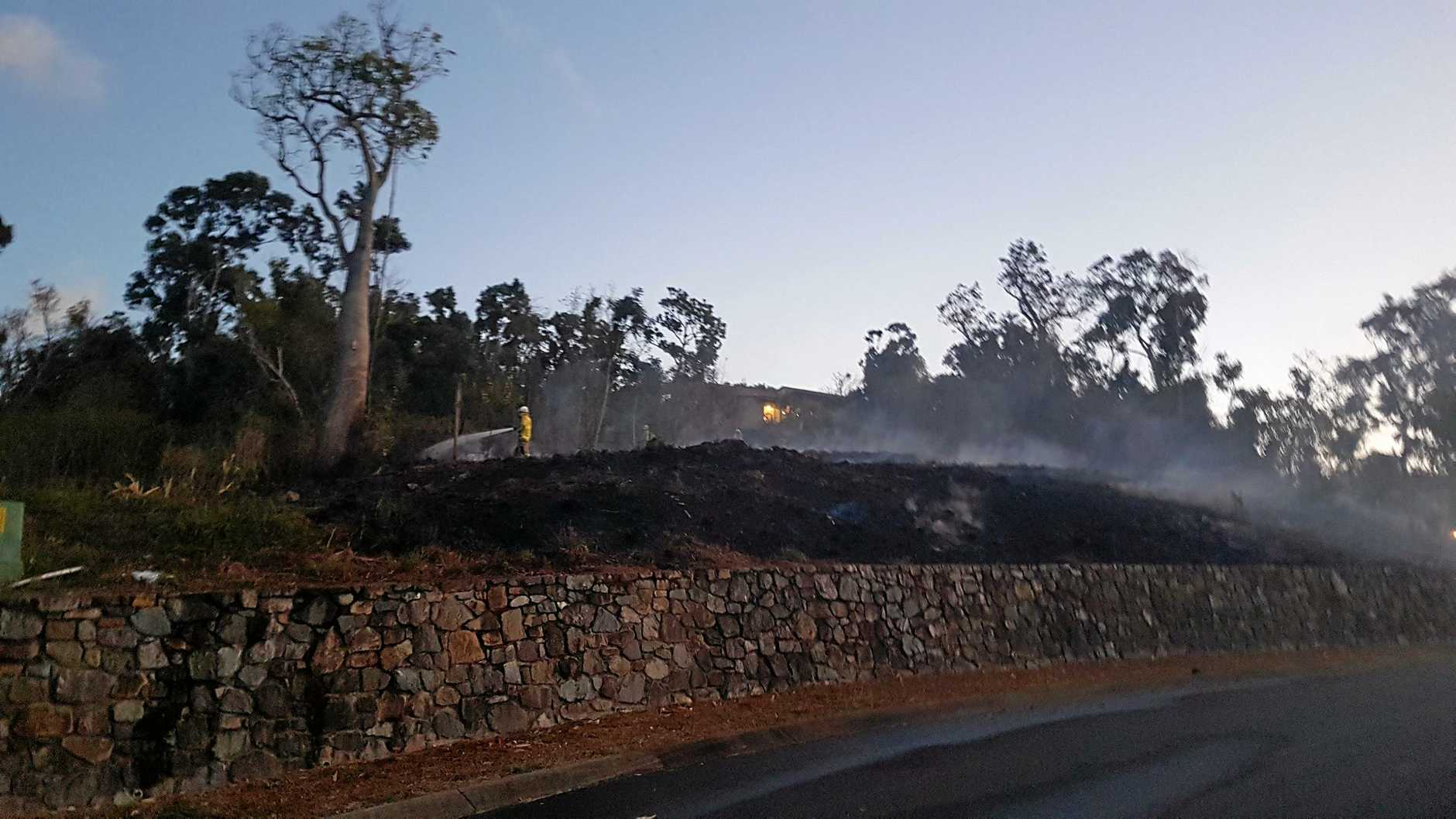 Firefighters dampen down a fire in Satinwood Crt in Airlie Beach on Wednesday.