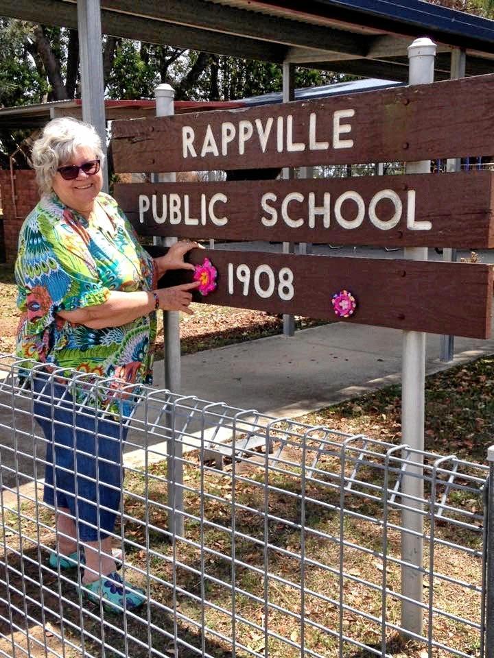 Kyogle's Lynda Clark yarn bombs Rappville sign and school.