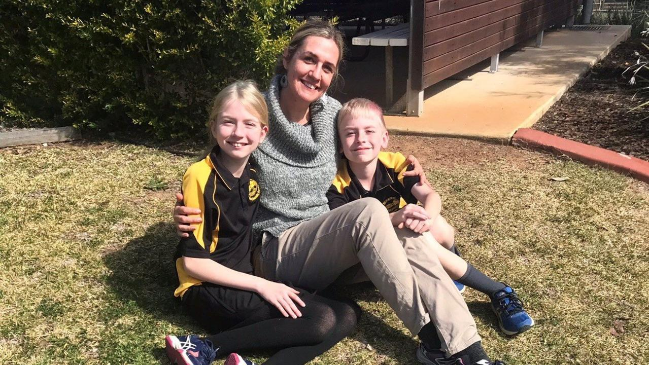 Blackbutt's inclusion teacher Simone Newitt, with her two 'proud to be autistic' children Indigo and Kyan.