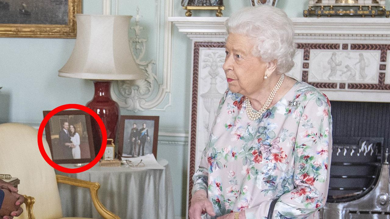 The Queen's framed photo of Meghan and Harry has been removed from her portrait table. Picture: Victoria Jones - WPA Pool/Getty Images