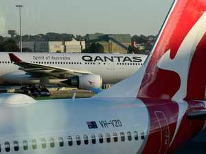 Qantas takes $55m profit hit