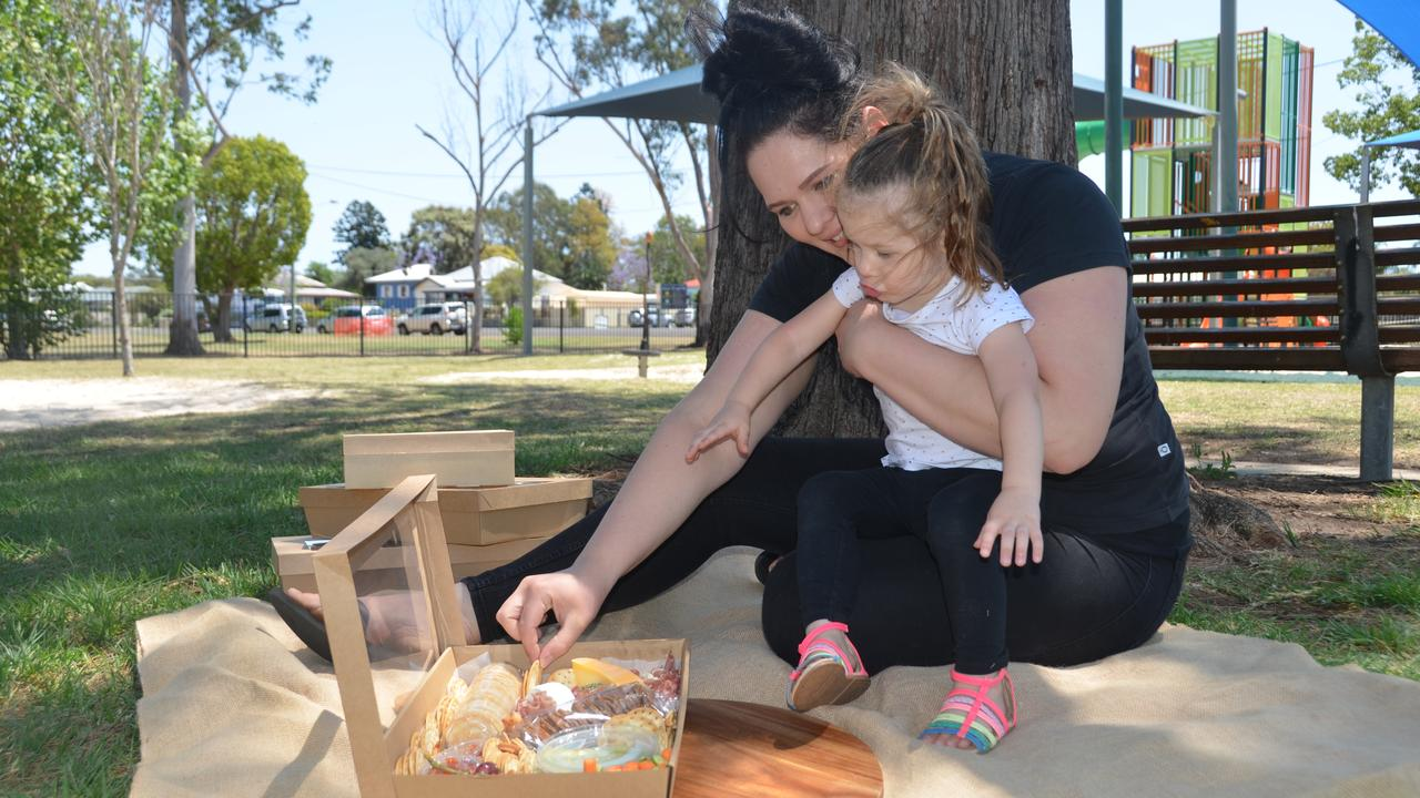 PICNIC: Laura Wilson and her daughter Aaliyah try out one of the 'Divine Grazing' boxes. (Photo: Jessica McGrath)