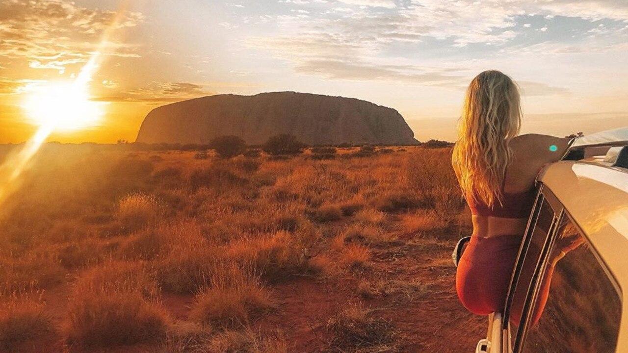 Tegan admires Uluru.