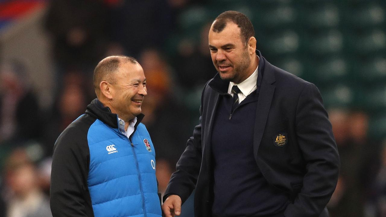 England coach Eddie Jones (L) with former Australia coach Michael Cheika. Picture: Adrian Dennis/AFP