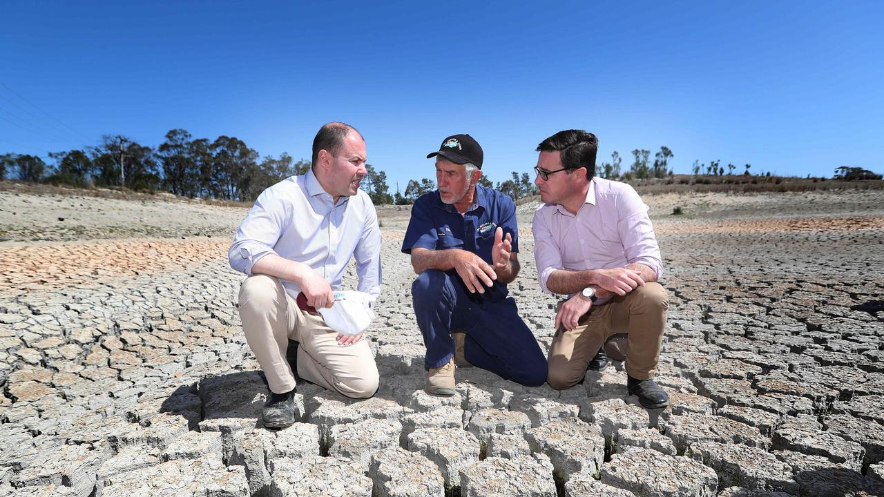 Treasurer Josh Frydenberg and Minister for Drought and Water Resources David Littleproud inspect the devastating drought conditions on Dino Rizzato's farm at Cottonvale, near Stanthorpe. Picture: Kym Smith