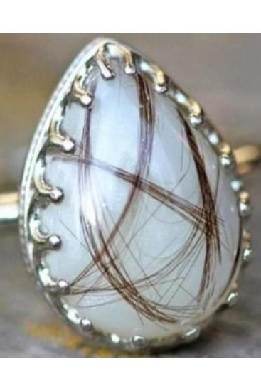 The bespoke ring includes her breast milk and her baby's hair. Source: Facebook