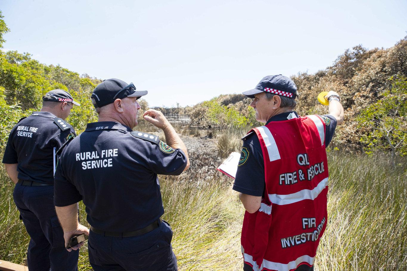 Fire investigators at the scene near the ignition point of Wednesday's Peregian Beach bushfire. Photo: Lachie Millard