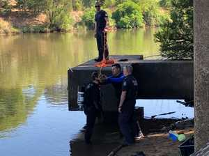MISSING GUN: Divers scour river for clues in shooting case