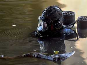 PHOTOS: Divers search for gun used in shooting
