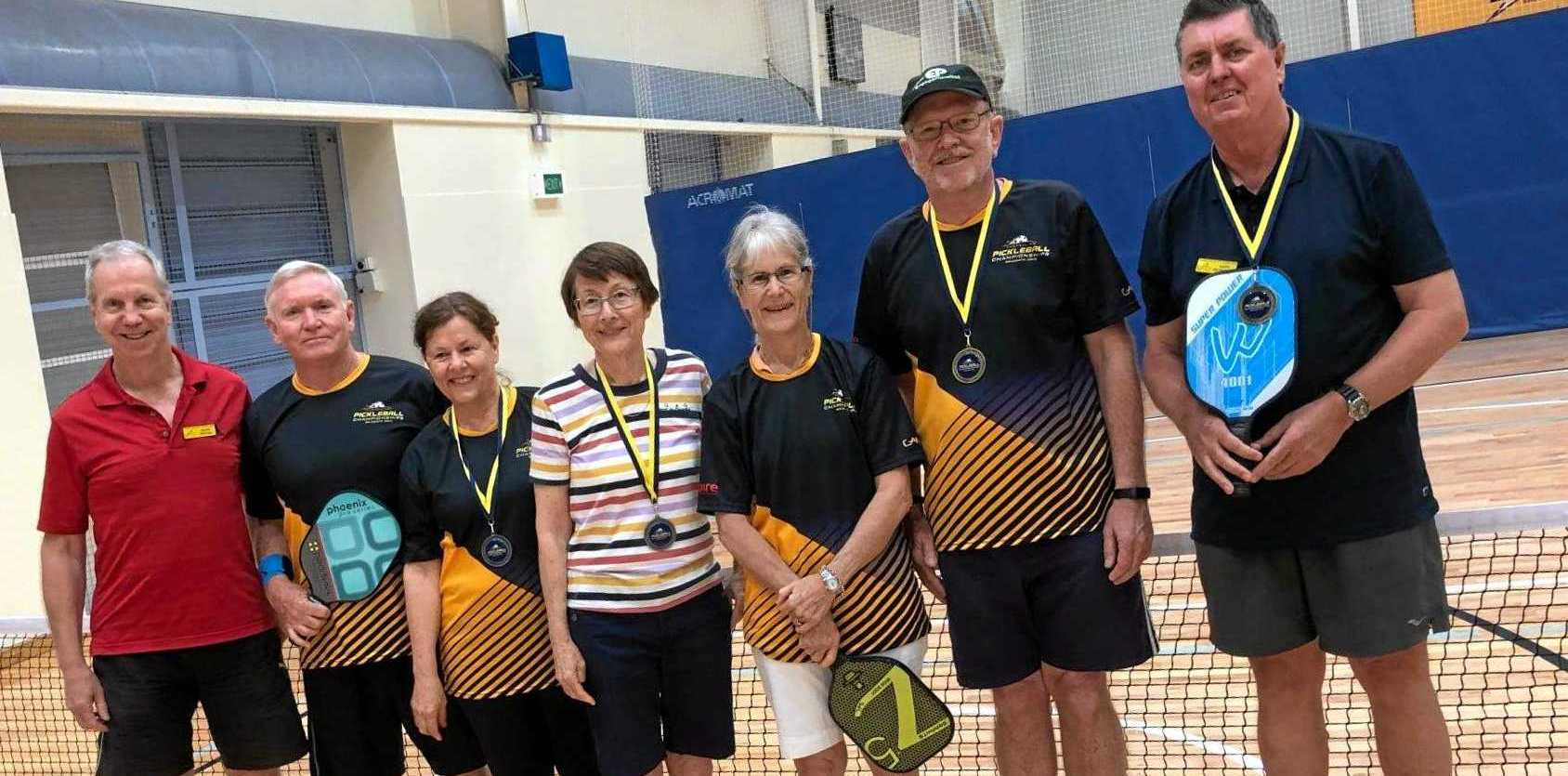 U3A Sunshine Coast's first Pickleball champions - Peter Deacon, Michael Drummond, Roslyn Smart, Lesley Seto, Sandee Leslie, Bruce Winther (U3A  Pickleball coach), and Gary Petterson  competed in the National Championships held recently in Brisbane, and some achieved silver and gold medals.