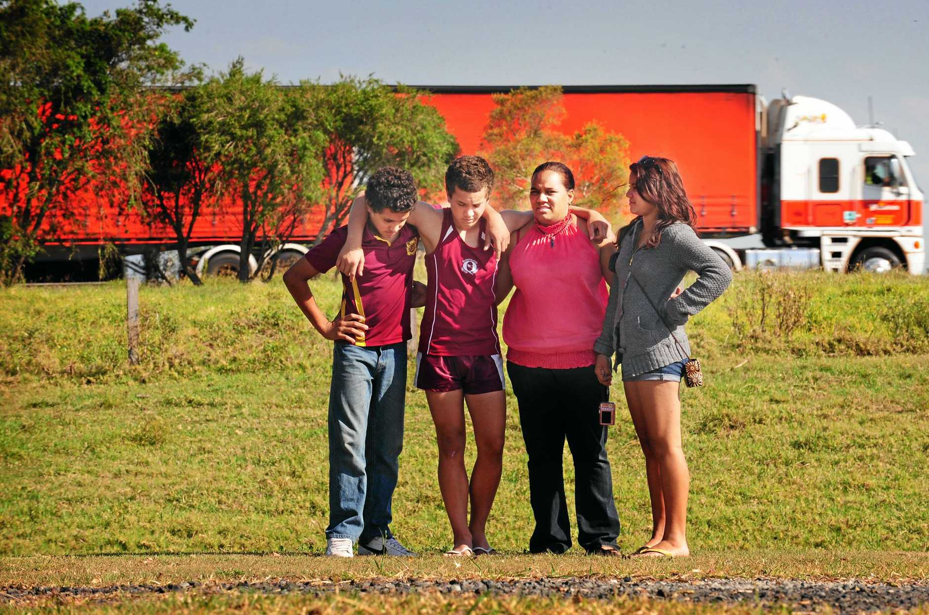 Cowper bus crash survivor Natisha Pitt (3rd from left) with her children William, 12, Alexander,13 and Elizabeth, 15 at the site of the Cowper Bus Crash memorial.