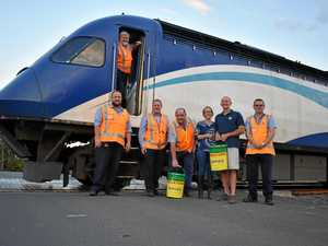 XPT makes unusual stop to deliver lollies and cash