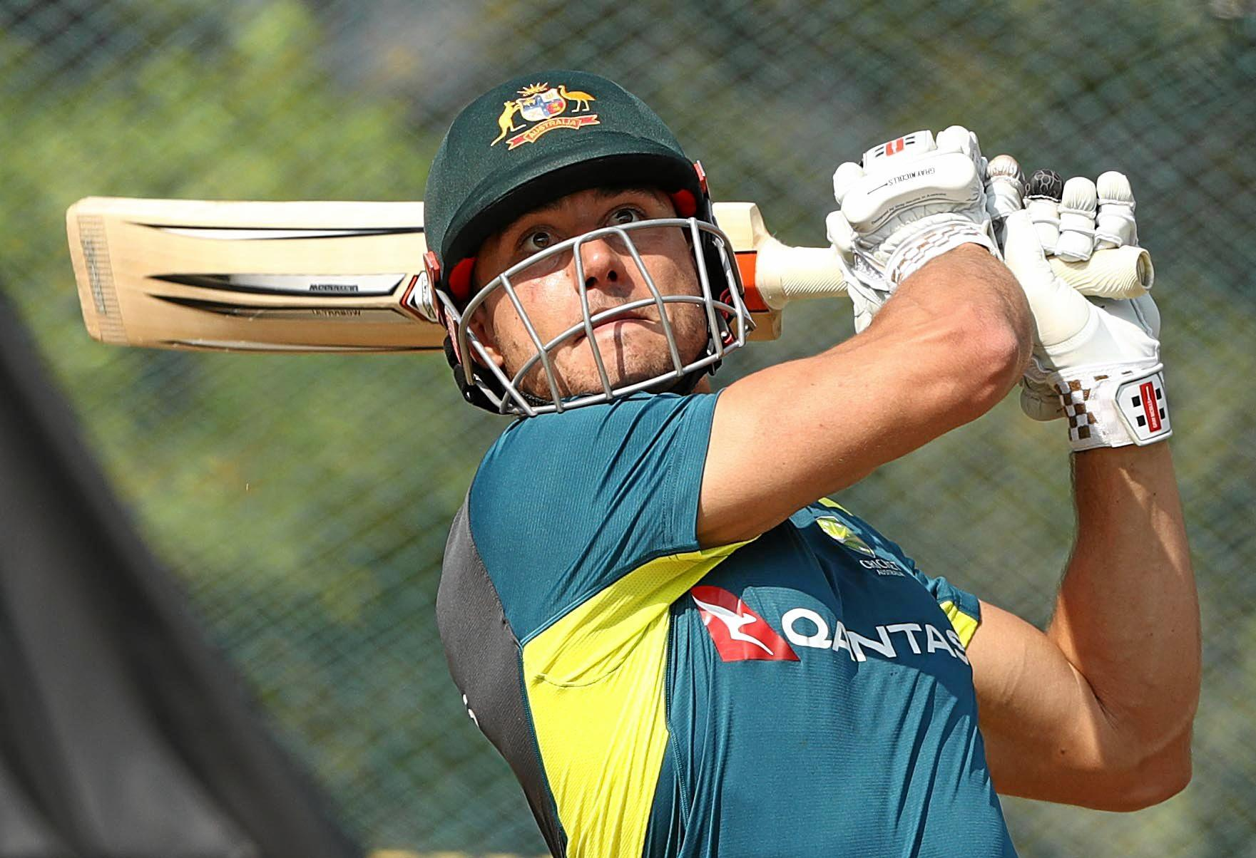 Stoinis works on his batting in the nets with the Australian team.