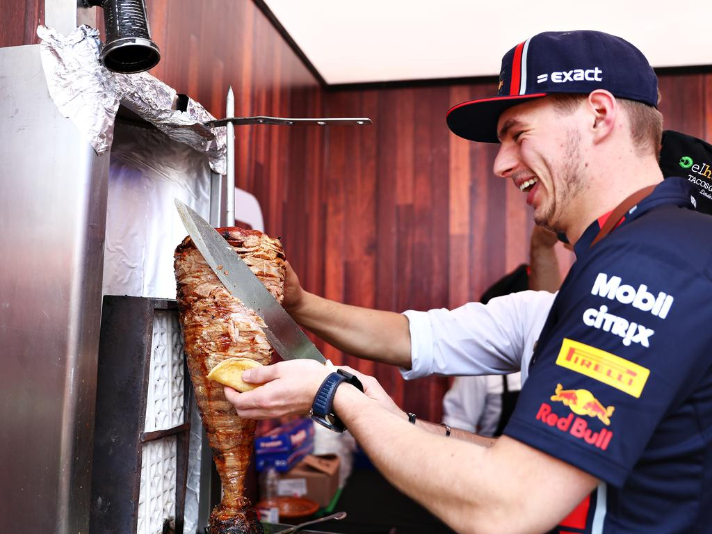 Max Verstappen otries his hand at preparing tacos in the paddock. (Photo by Mark Thompson/Getty Images)