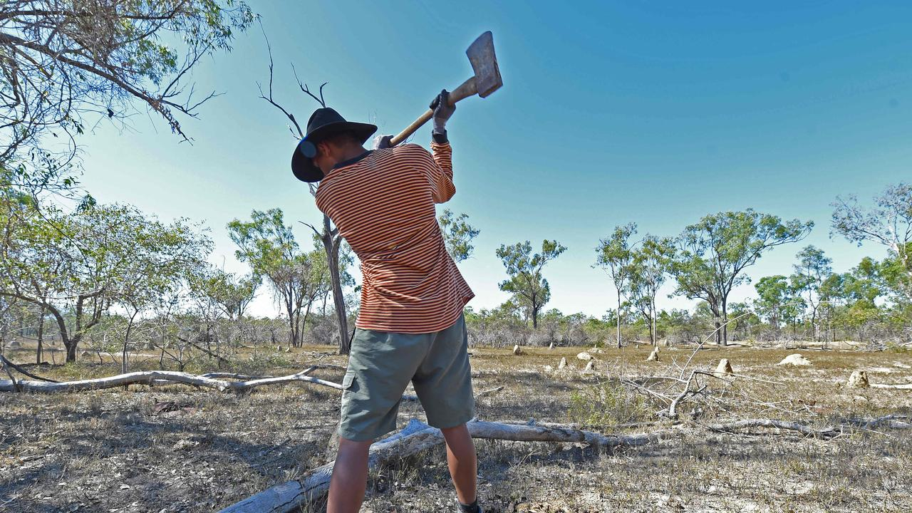 Yinda Camp at Braden Downes station in Woodstock. Boy who is taking part in the Yinda Camp Robbie uses an axe to cut wood for the camp fire. Picture: Zak Simmonds