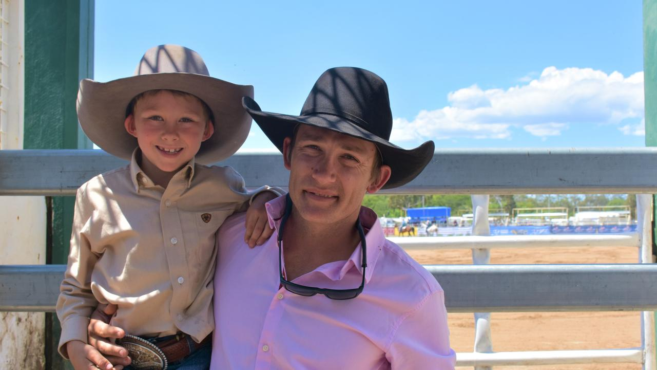 TOUGH RIDE: 2018 Saddlebronc champion Cameron Webster with his son Max as he prepares for this year's competition.