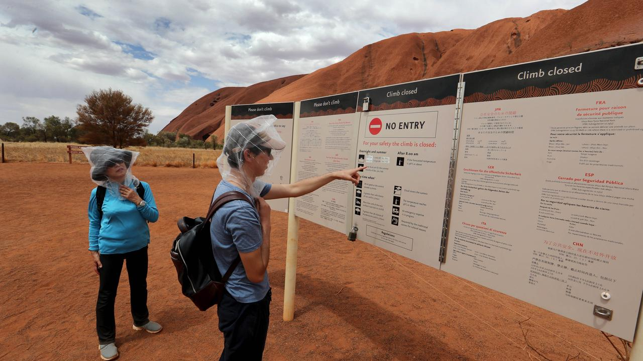 A group of Japanese tourists missed out on climbing Uluru yesterday after it was closed due to the temperature reaching 40 degrees. Picture: David Geraghty/The Australian