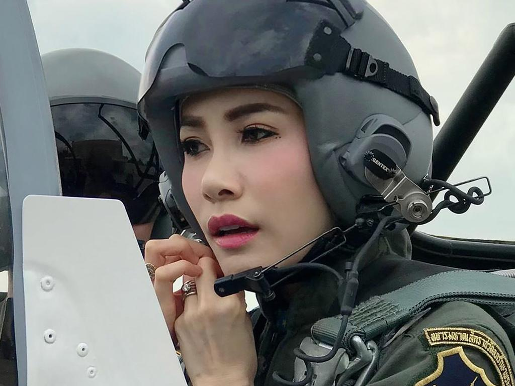 Pilot Sineenat in the cockpit of a military jet. Picture: Thailand Royal Office via AP