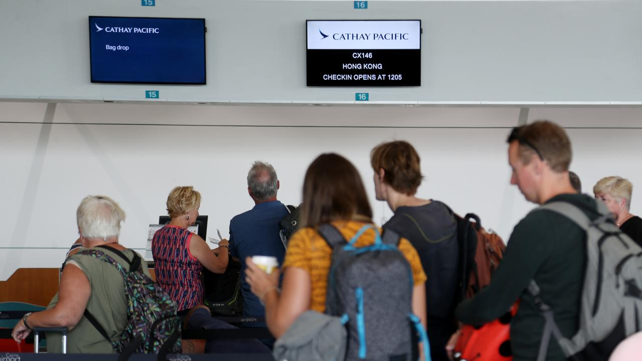 Travelers ready to board one of the last Cathay Pacific flights direct from Cairns to Hong Kong. PICTURE: STEWART MCLEAN