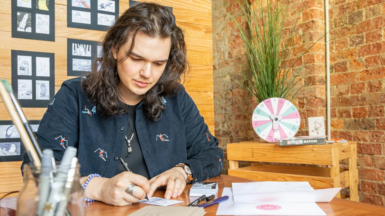 Brendan Peace hard at work drawing penises. Picture: Nelson Zambrano @oneclick_nz