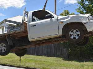 Ute carves up Gympie yard in midnight crash