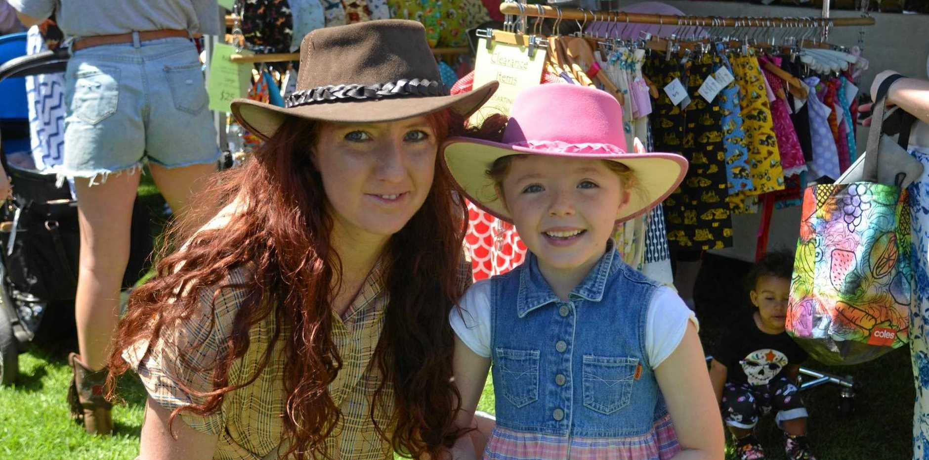MARKET MAGIC: Nicole and Sienna Zelvis enjoy having a browse through the stalls.
