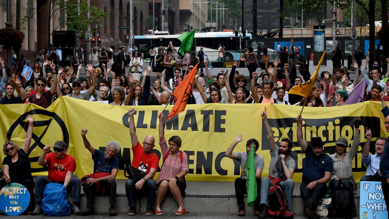 Extinction Rebellion protesters are seen at a rally in Martin Place in Sydney. Picture: AAP/Bianca De Marchi