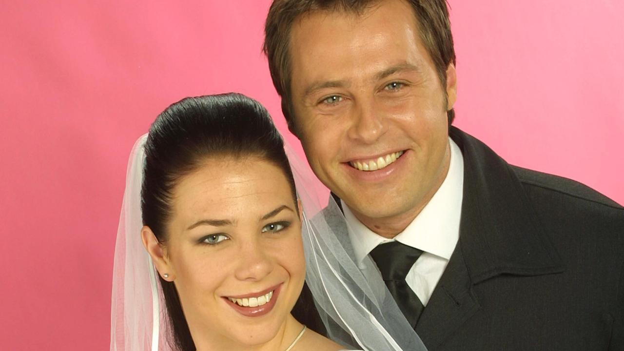Actors Kate Ritchie and Joel McIllroy pose for a Home And Away wedding.