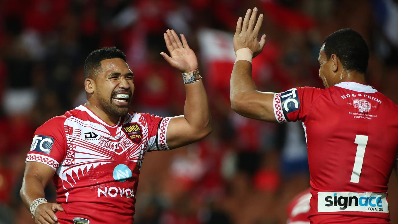 Tonga celebrate the massive win over Great Britain.