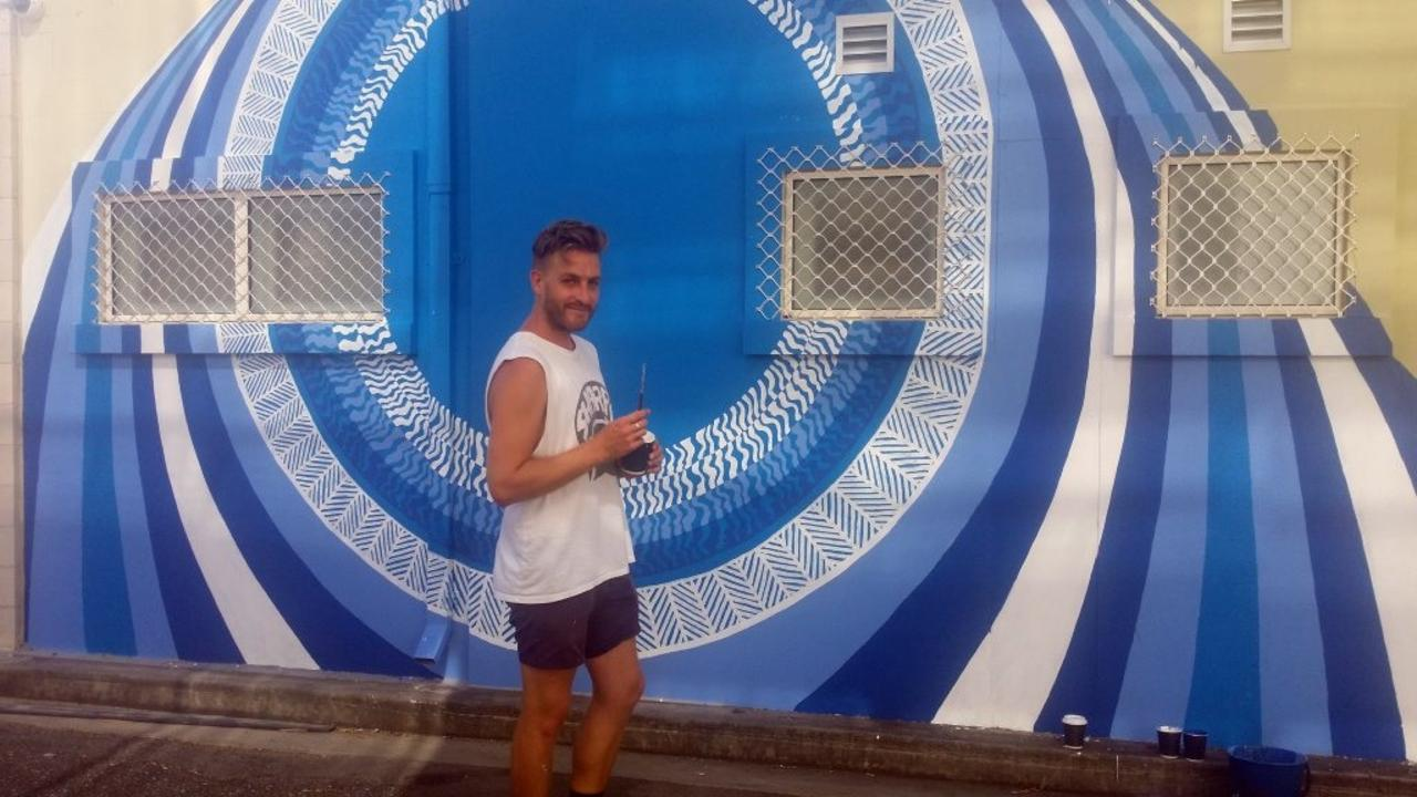 COMMISSIONED MURAL: Internationally renowned artist Lucas Grogan painted his last signature mural in Quay Lane, Rockhampton in 2015 before leaving to live and work in Europe.