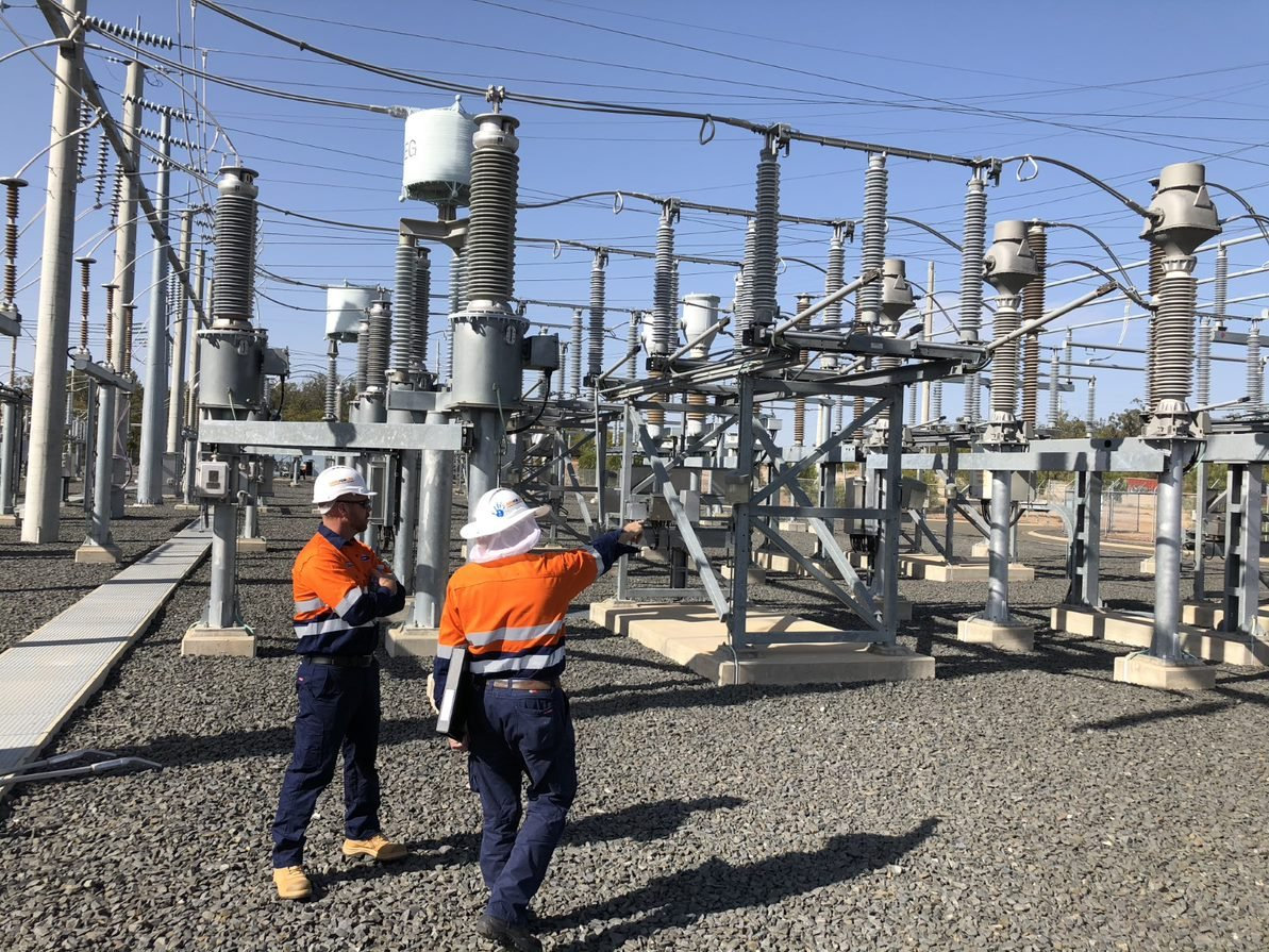 Powerlink workers at the Columboola sub station.