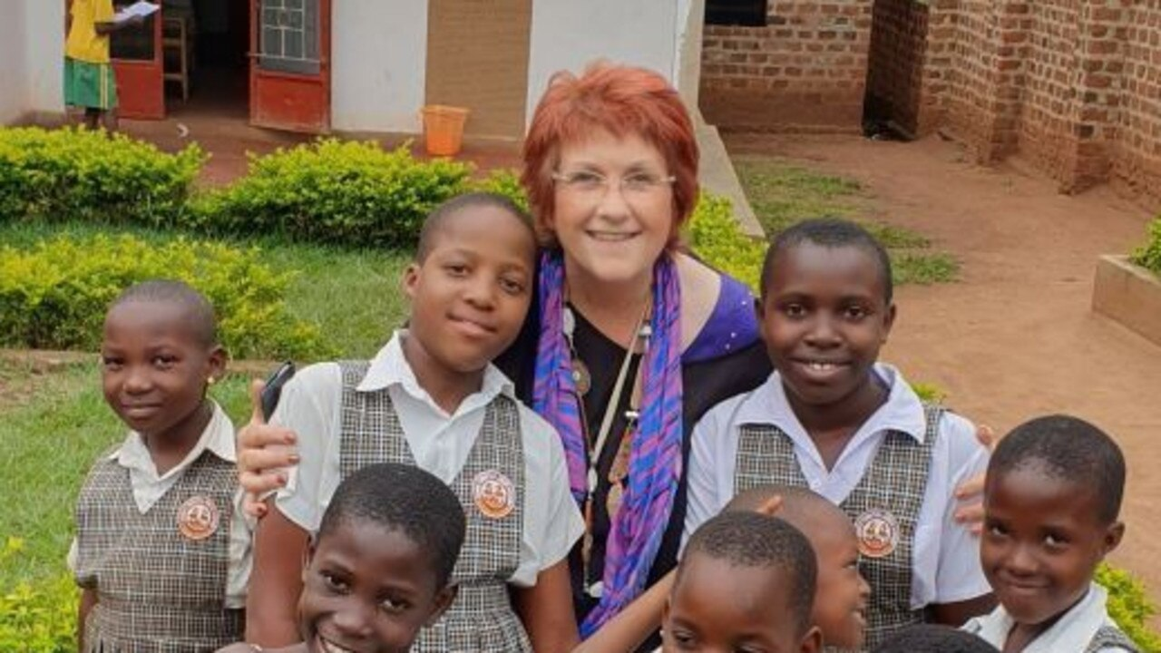 Bette with students during her trip to Uganda.