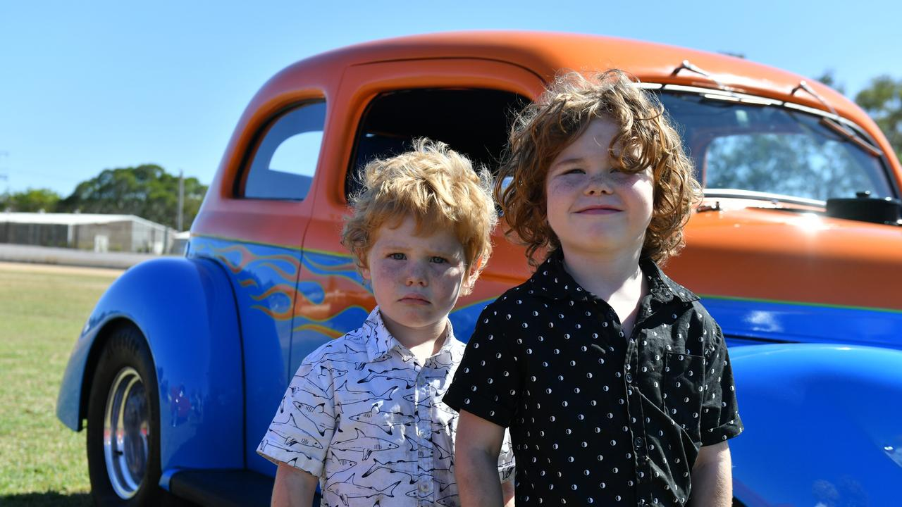 Thomas (4) and Sebastian (5) Reynolds at hot rods for the homeless at the Gladstone showgrounds on October 26.