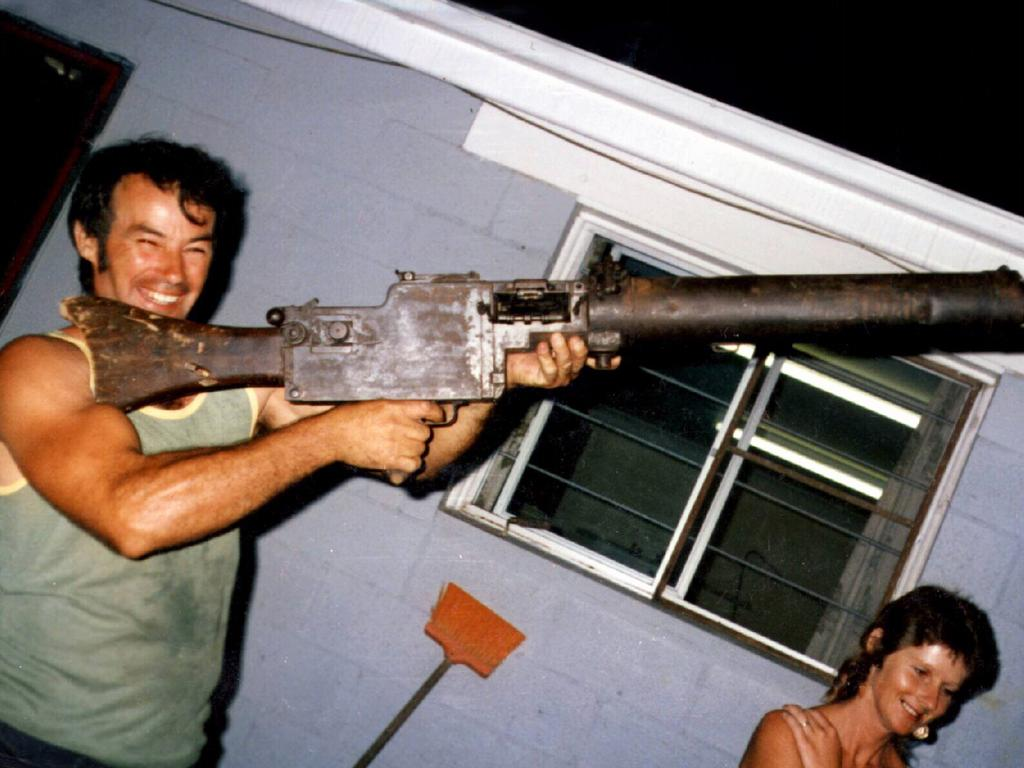 Milat in 1983, holding World War One vintage machine gun at the Southern Highlands home of his brother Alex Milat.
