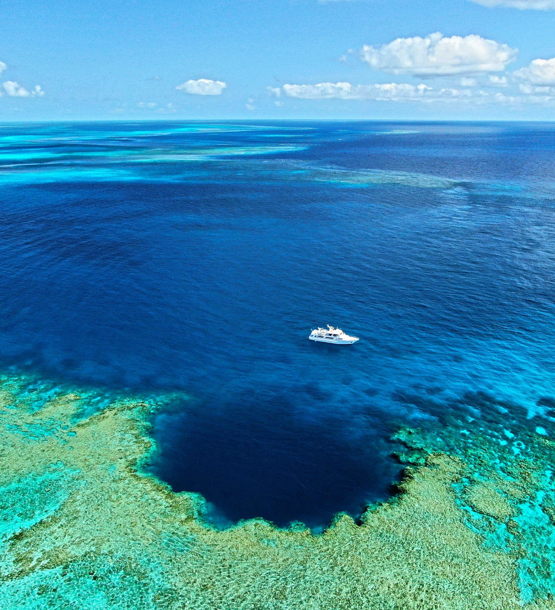 ONE TIME USE ONLY: A Birdseye view of the 78 m blue hole Johnny Gaskell ventured out to.