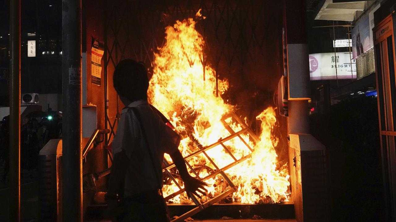 The entrance to a subway station is set on fire during a protest in Hong Kong. Picture: AP