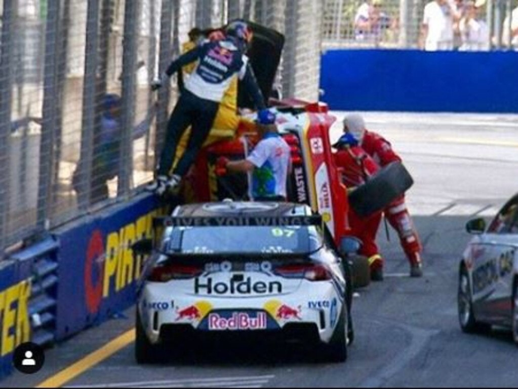 Shane van Gisbergen climbs up the wall.
