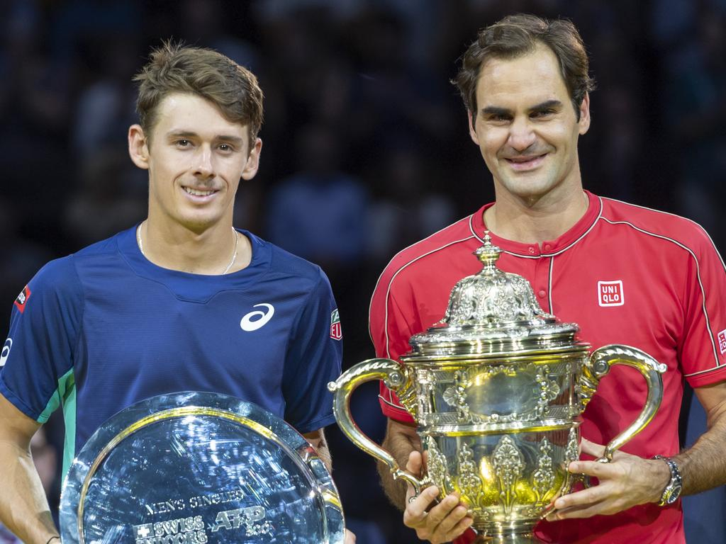 Switzerland's Roger Federer, right, and Australia's Alex De Minaur, left, pose after the final at the Swiss Indoors tennis tournament. Picture: Georgios Kefalas/Keystone via AP