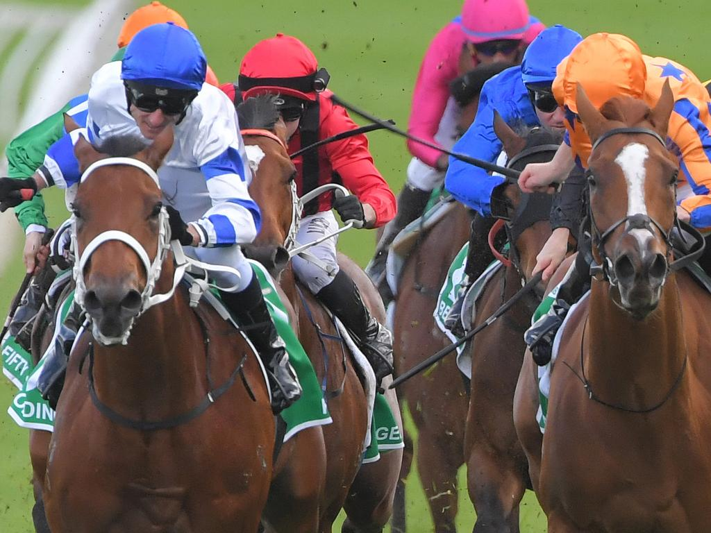 Glen Boss (left) combines with Kolding to claim the Epsom.