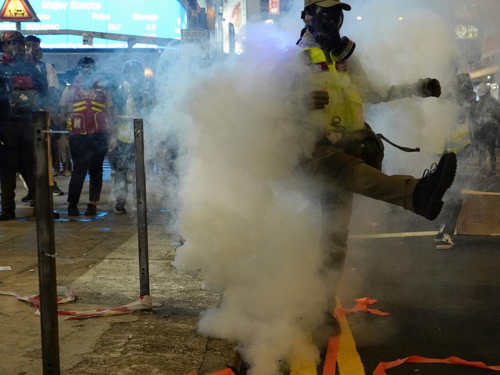 A protester reacts to tear gas in Hong Kong. Picture: AP