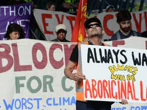 Activist glued to road as anti-coal protest continues