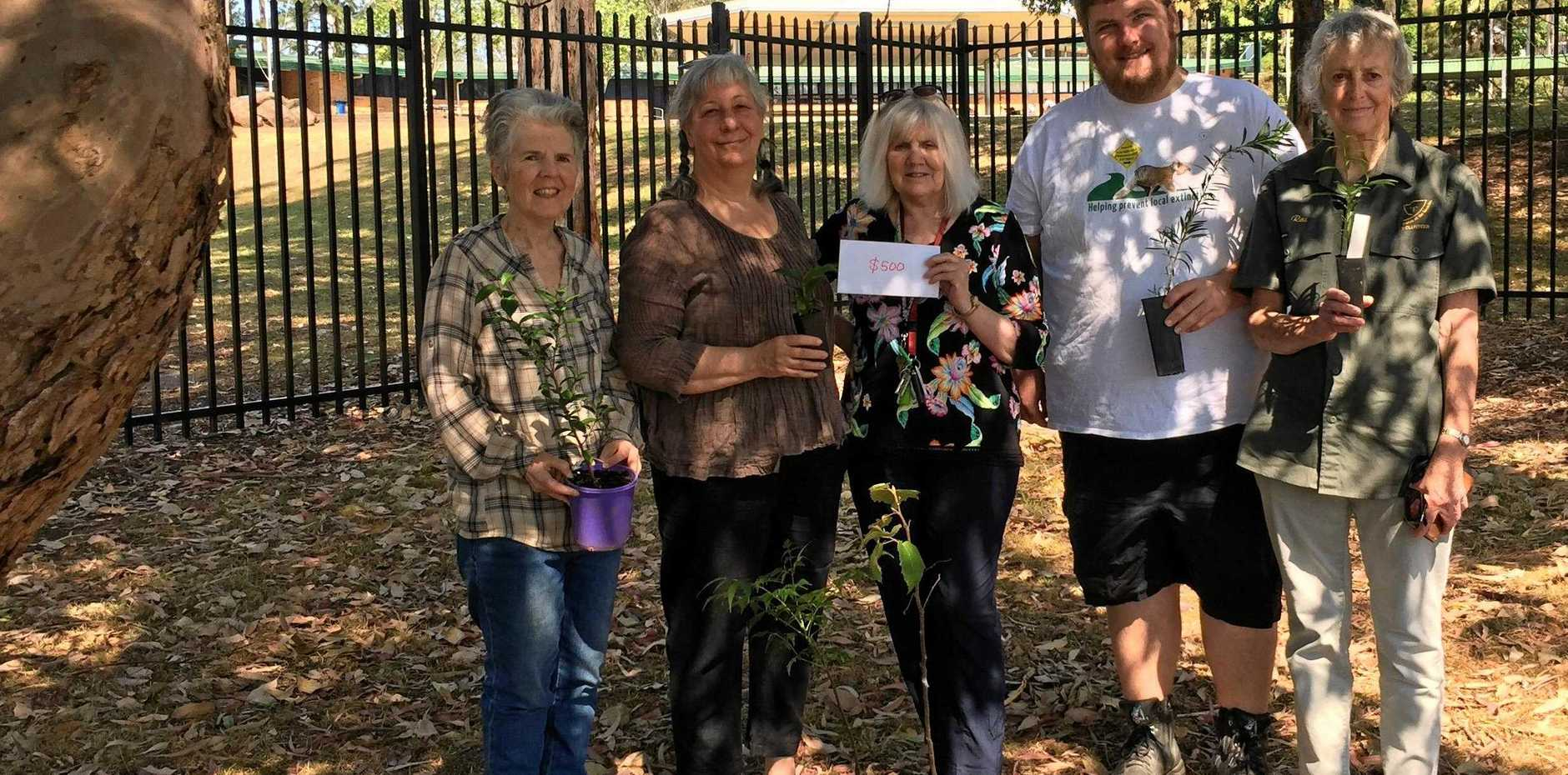 RICH PICKINGS: Friends of the Koalas Mark Wilson, Corena Wynd of Upper Tucki Tucki Creek Landcare and Dr Kristin Den Exter of Wilsons River Landcarers and Lismore Theatre Company members Elyse Knowles and Luke Kane meet to discuss just how to use the LTC's compensation money.