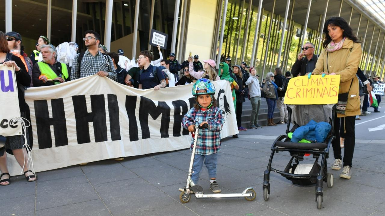 A woman and child at the protest. Picture: Jake Nowakowski
