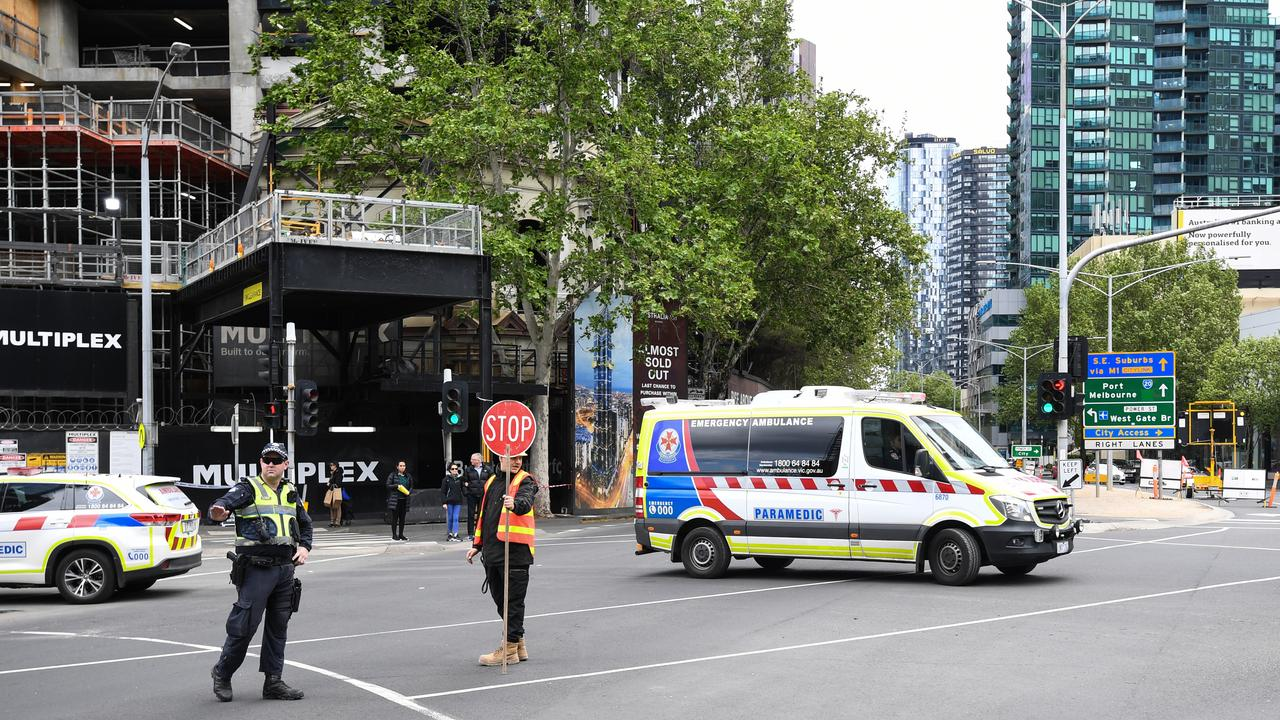 An ambulance leaves the scene of a construction site accident in Southbank. Picture: AAP