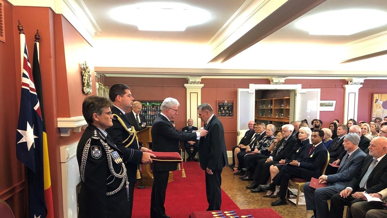 Gympie region grazier Henry Bath receives his Order of Australia Medal from Governor Paul De Jersey.