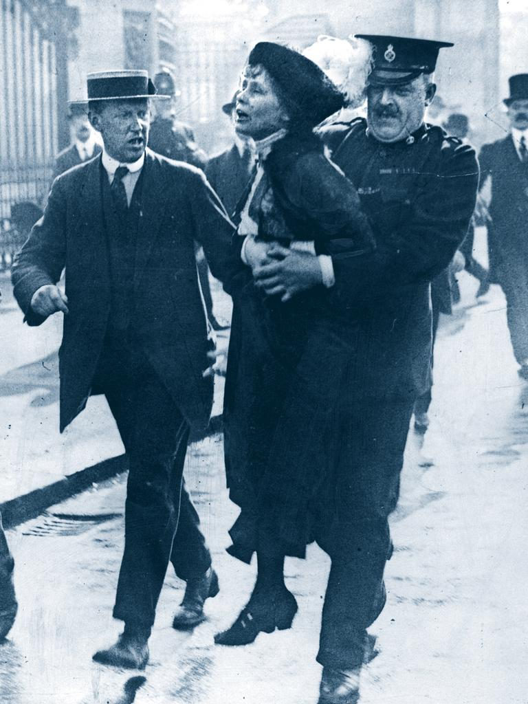 Scenes from London in the early 1900s … Police remove suffragette Emily Pankhurst from a protest outside Buckingham Palace in 1905.