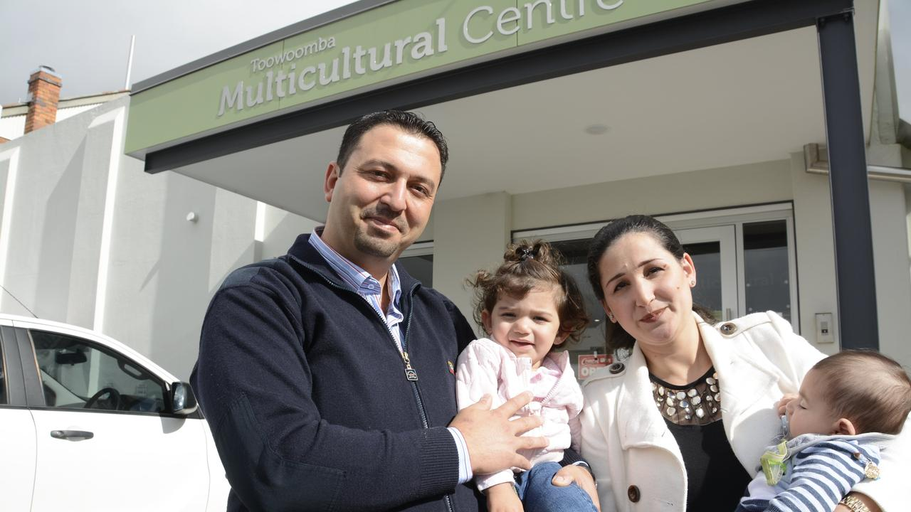 NEW LIFE: Former Yazidi refugee Jankey Joweesh celebrated the opening of the Toowoomba Multicultural Centre with his children Ciemav and Stervan and wife Dilvina Abdo.